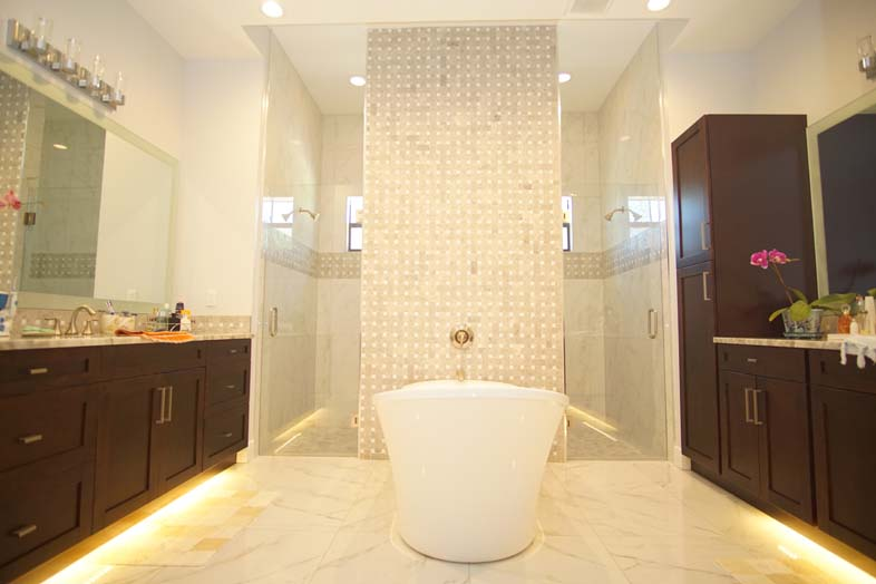 Luxurious bathtub and shower in bathroom built by SPEC Development
