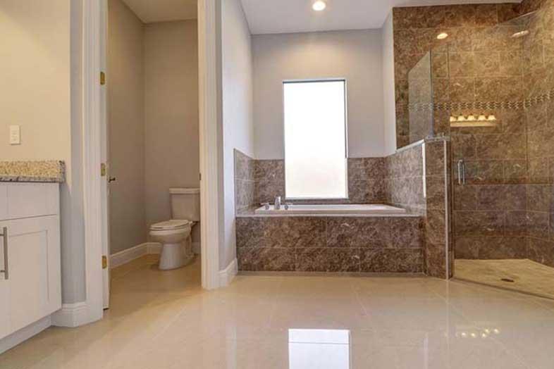 Bathroom granite shower, designed by SPEC Development