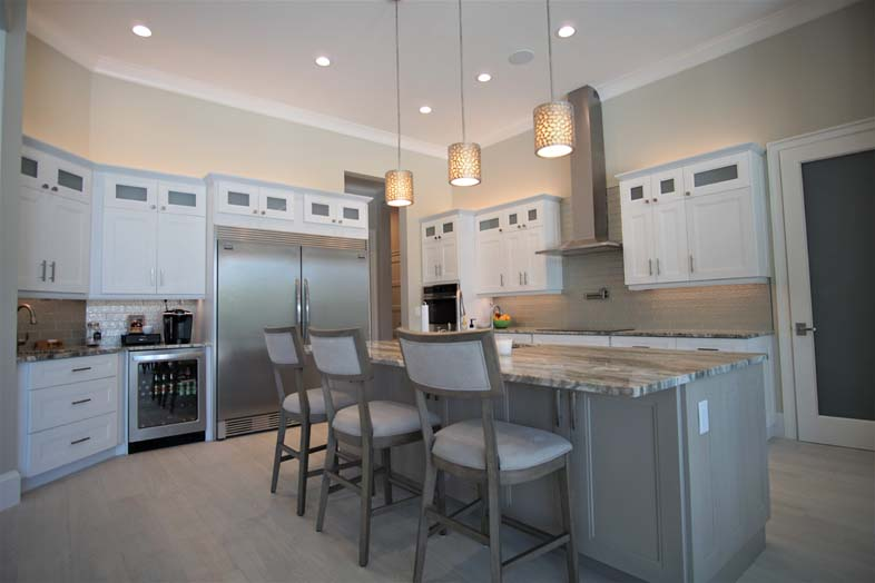 Beautiful kitchen with white cabinets and island, designed by SPEC Development