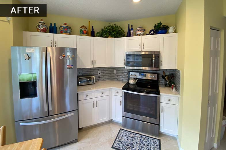 Kitchen remodel, white cabinets with grey subway title